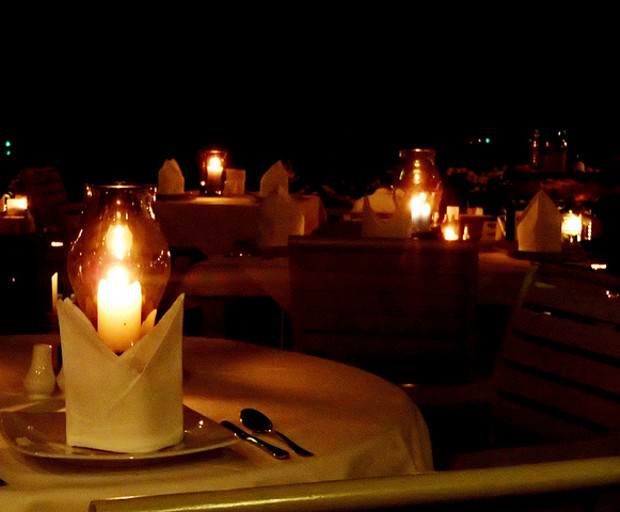 A  candle-lit dinner is one of many simple ways for romancing your man