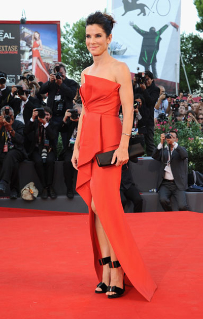 Sandra Bullock stole the show in a red carpet red J. Mendel strapless gown