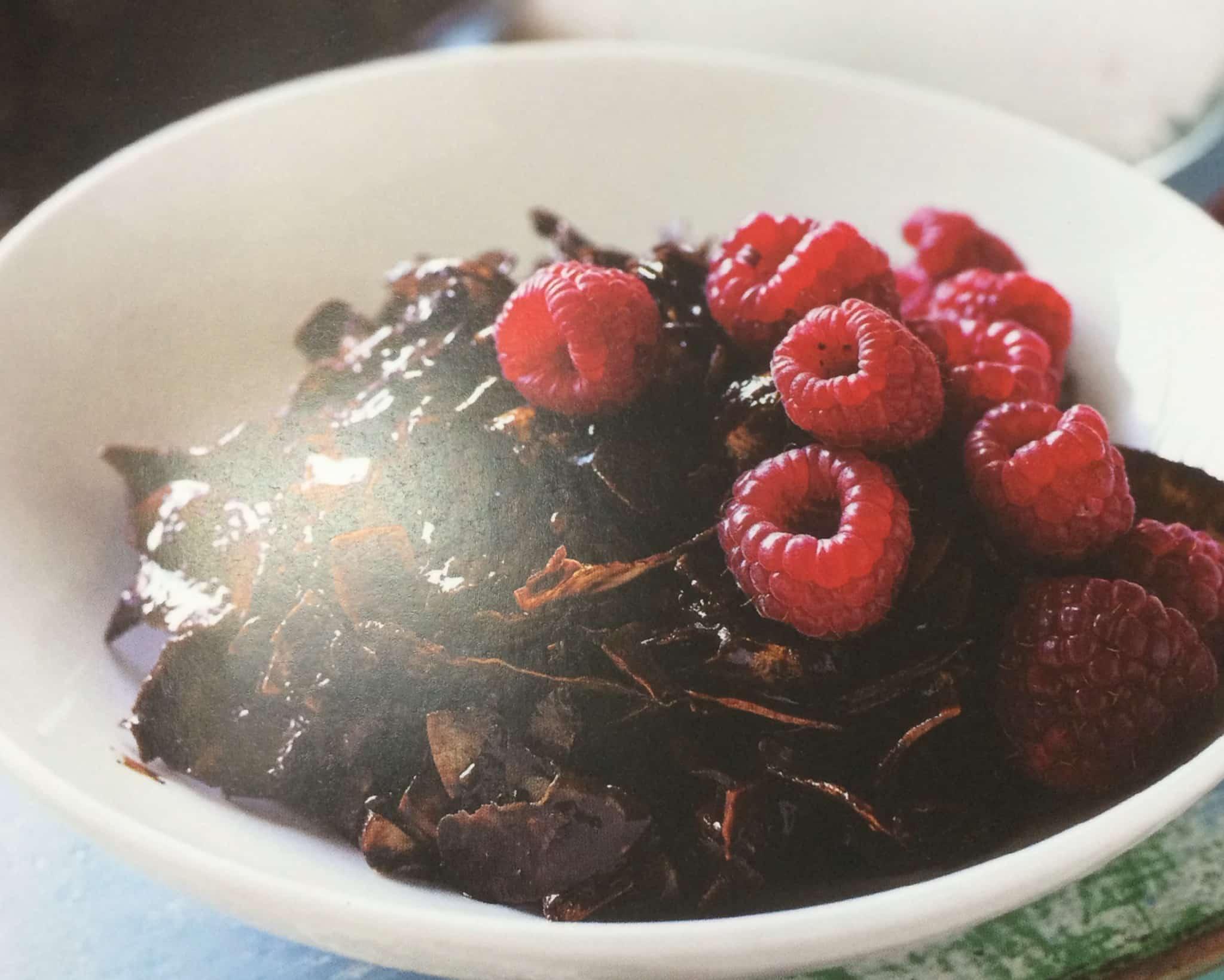Crunchy granola, raspberries, coconut cream