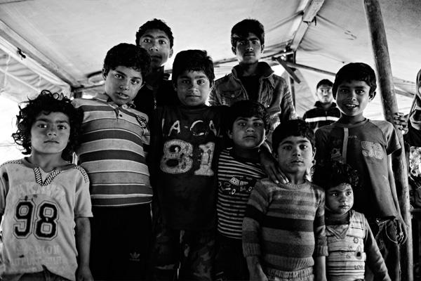 Syrian boys in a refugee camp in Reayhanli.  (Procyk Radek / Shutterstock.com)