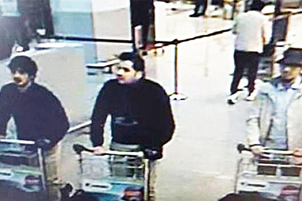 Federal police said this image shows the suspects at Brussels airport before the bombs where detonated. Federal police are currently searching for the man on the right.