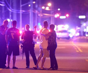 Shocked friends and family members wait on the street outside the nightclub for news of survivors.