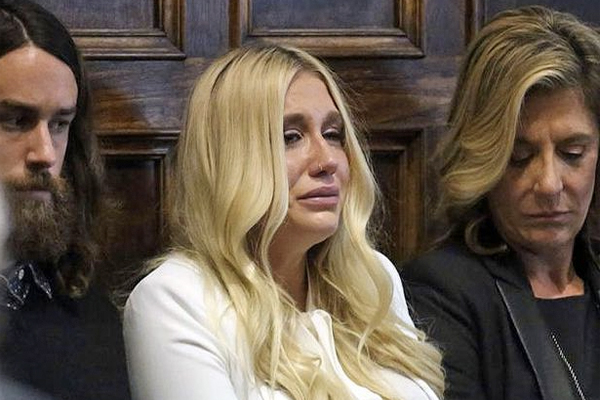 An emotionally distraught Kesha breaks down in court after her case is dismissed against alleged abuser, Dr Luke.