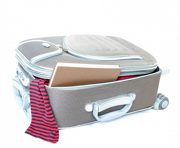 efficient packing, travel tips, packing, suitcase, travel essentials