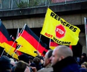refugees, Angela Merkel, transgender, violence, Germany, Dortmund