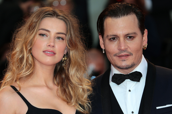 Keeping up appearances: Heard and Depp at a red carpet event.